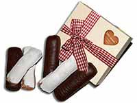 Geschenkidee von Ischler Lebkuchen: Holzkistchen gefüllt mit Weinbeisser