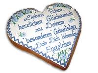 Traditionell beschriftetes Lebkuchenherz mit weißer Auflage